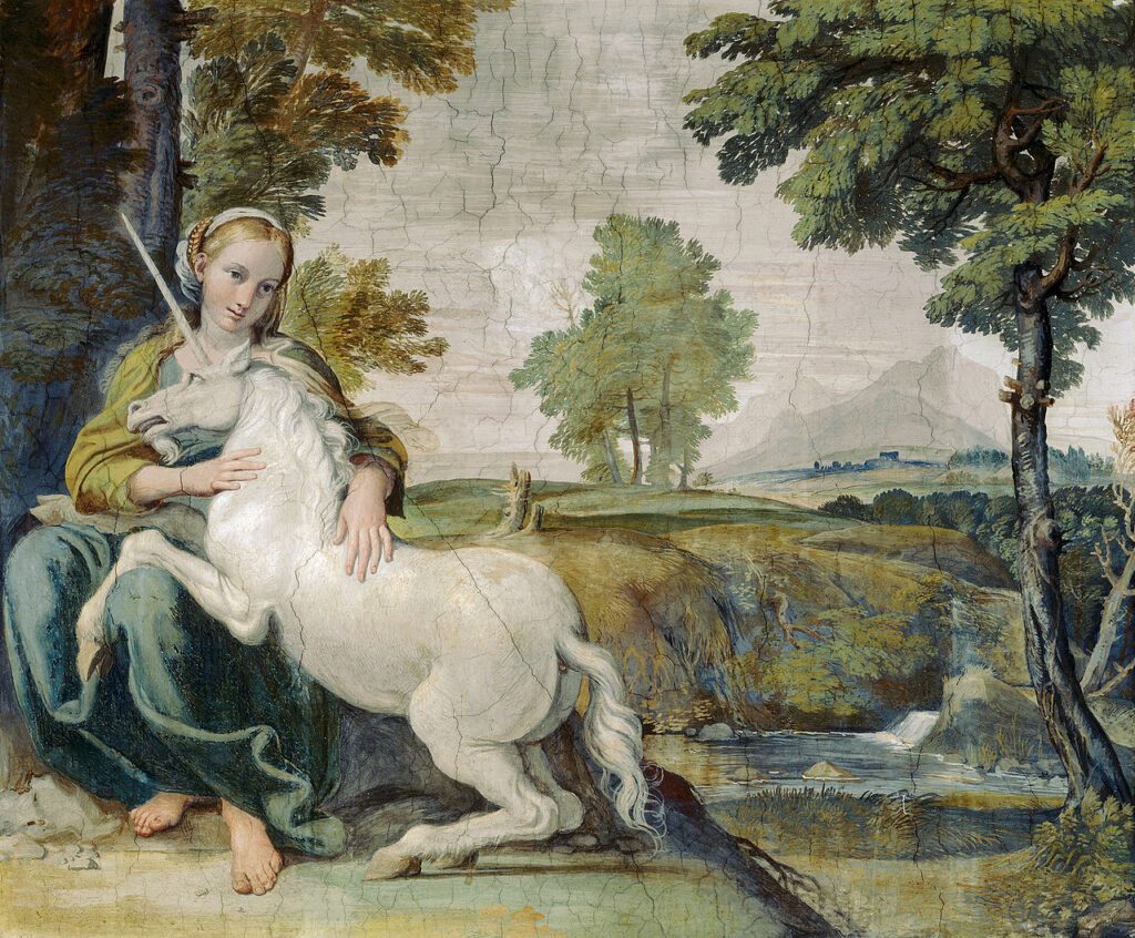 A painting of a white unicorn resting on the lap of a woman